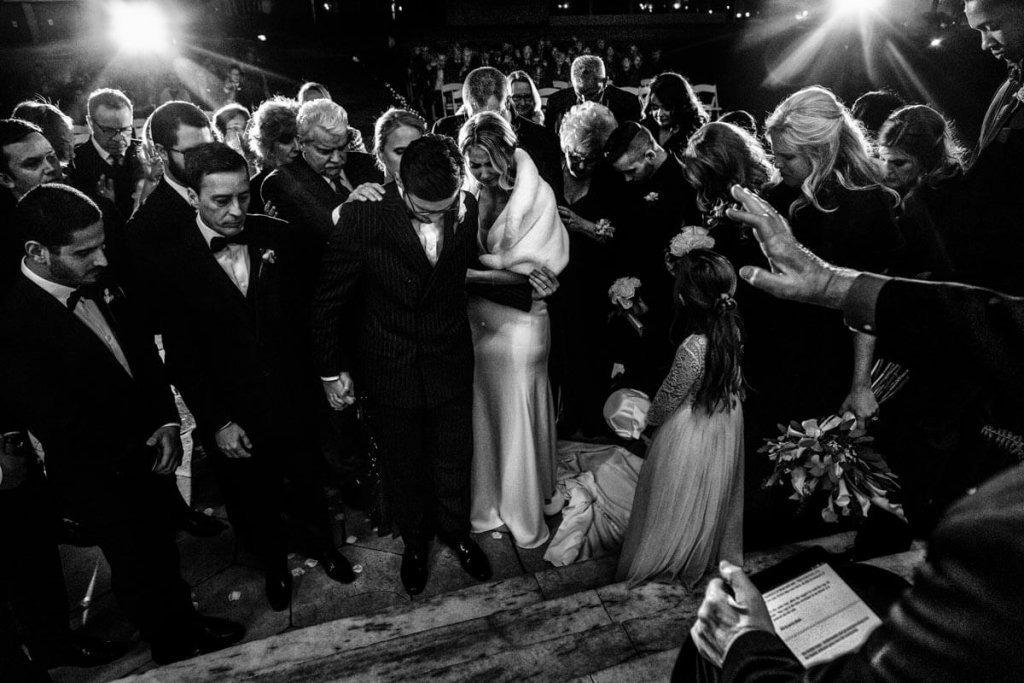 People praying for the wedding couple
