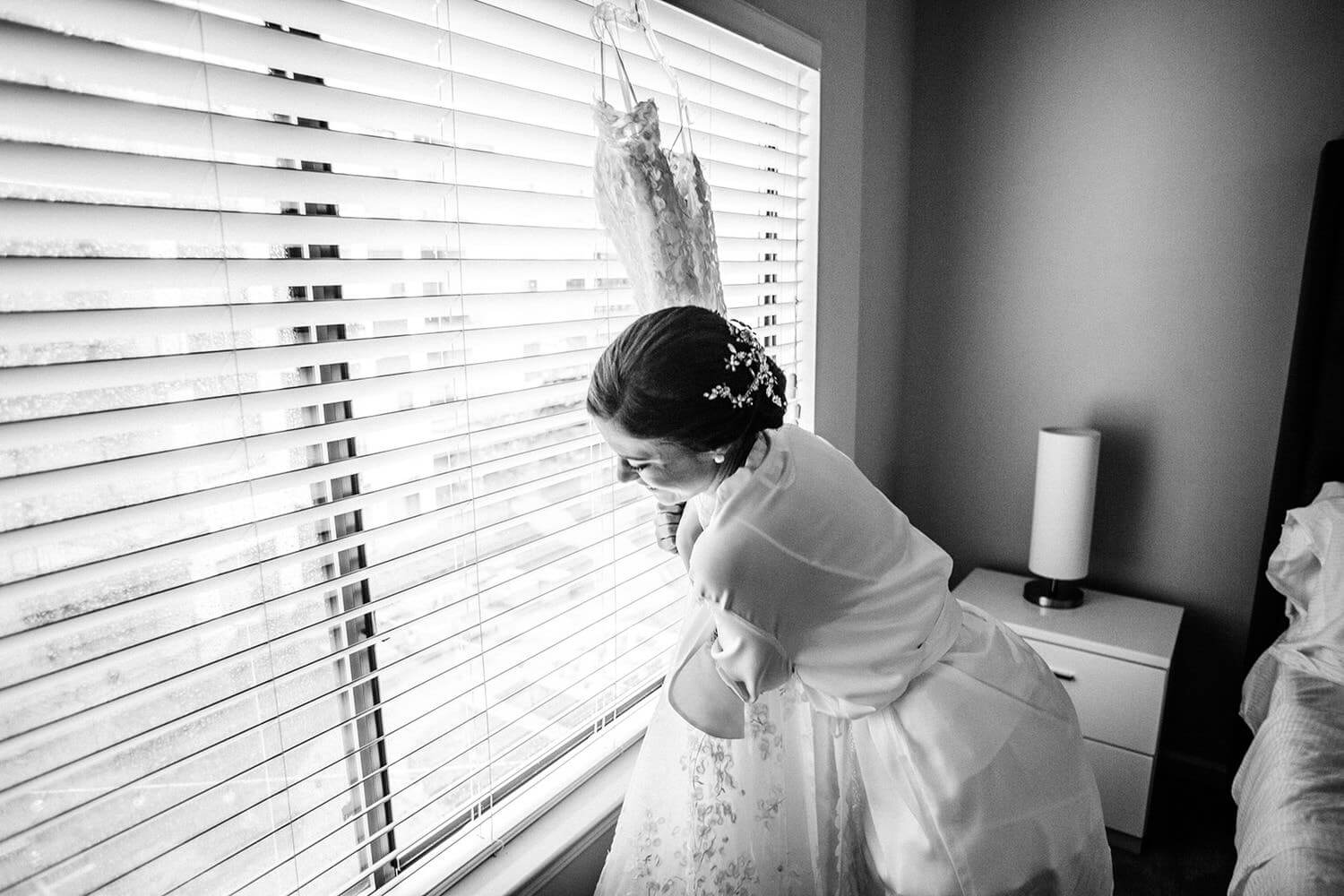bride hugging her with dress