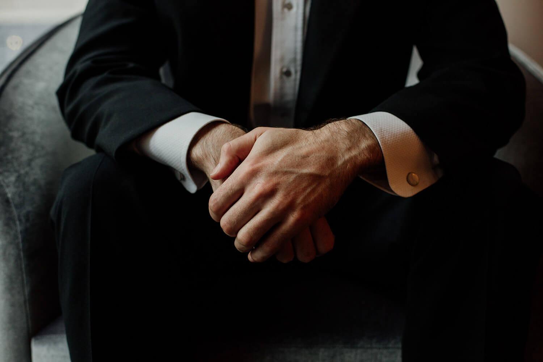 Groom hands