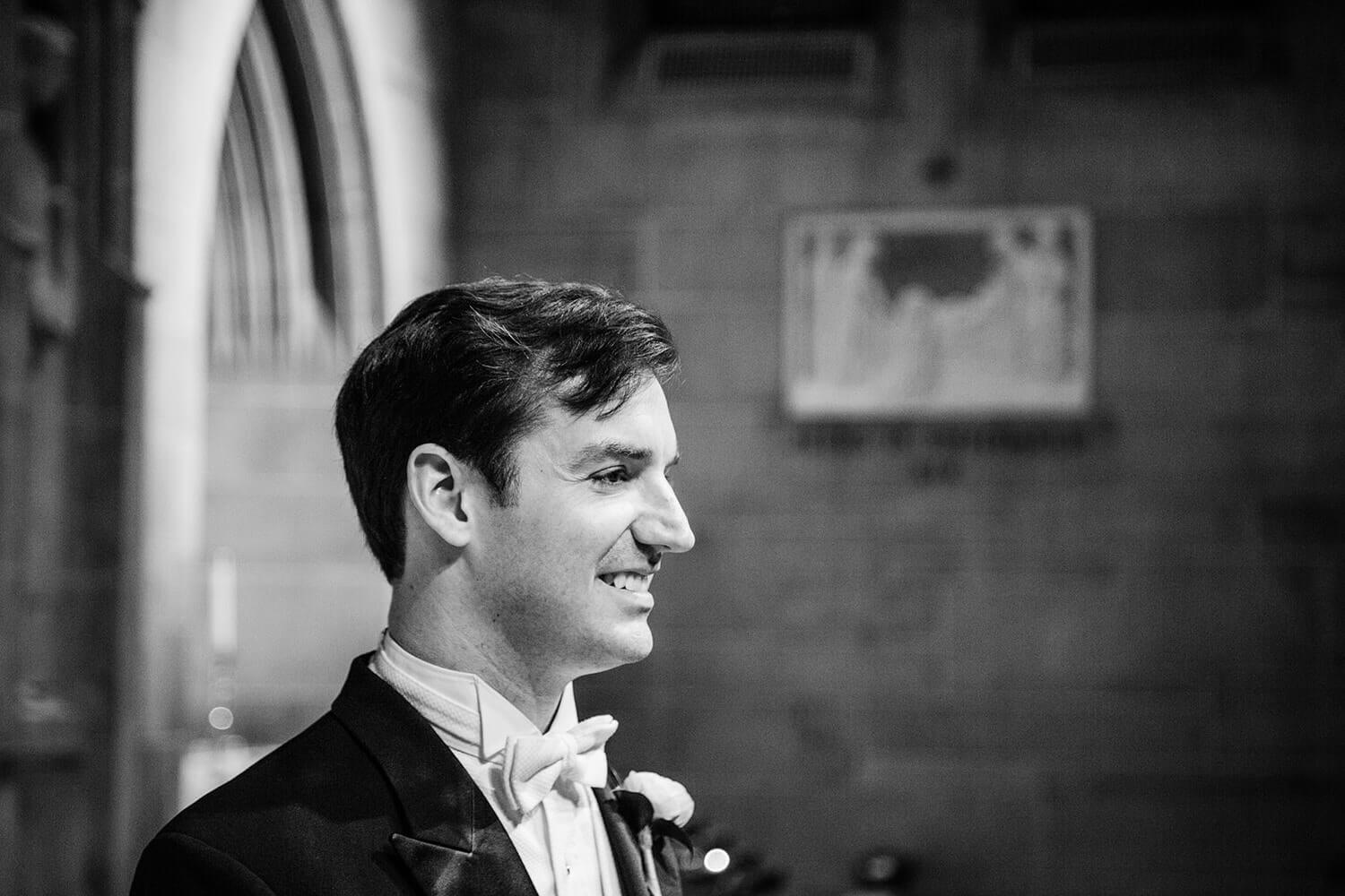 groom watching the bride entrance