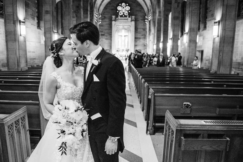 bride and groom wedding exit kiss