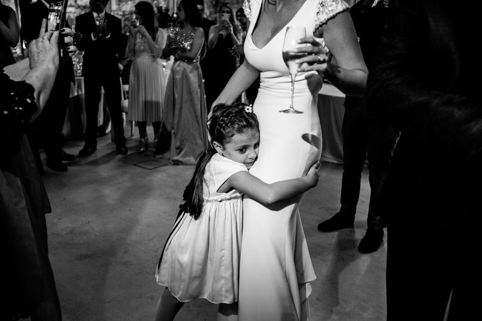 baby girl hugging the bride